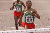 Haile Gebrselassie crossing the line to win the 2001 IAAF World Half Marathon Championships in Bristol (© Allsport)