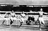 John Landy (AUS) takes the 1500m bronze behind Ron Delany of Ireland at the 1956 Olympics (Getty Images)