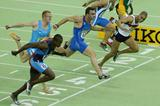 Jason Gardener (GBR) dips to the line to win the 60m World title (Getty Images)