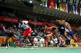 Dayron Robles of Cuba dips to beat Terrence Trammell in the men's 60m Hurdles Final (Getty Images)