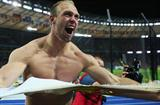 Germany's Robert Harting roars as he rips his vest off his shoulders in exultation in winning the men's Discus Throw at the 12th World Championships in Athletics (Getty Images)