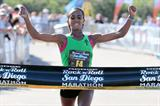 Bizunesh Deba of Ethiopia celebrates winning the San Diego Marathon (Victah Sailer)