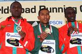 Zersenay Tadese of Eritrea shows off his gold medal alongside silver medalist Patrick Makau Musyoki of Kenya and Evans Kiprop Cheruiyot of Kenya (Getty Images)