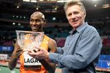 Bernard Lagat after taking his 8th Wanamaker Mile title at the 2010 Millrose Games; with seven-time winner Eamonn Coghlan, (Kirby Lee)