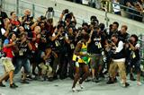 Photographers surround Usain Bolt at the IAAF World Championships (Getty Images)