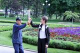 Mihalic hands the flame to Jevtic in the Park in front of Belgrade's City Hall (LOC)