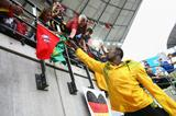 Triple World Record holder Usain Bolt of Jamaica signs autographs during the IAAF World Championships in Berlin (Getty Images)
