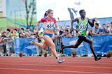 Tatiana Blagoveshchenskaia of Russia and Amedee Manirakiza of Burundi compete in the 8x100m mixed relay at the 2014 Youth Olympic Games (Getty Images)