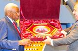 Moscow 2013 Lunch, 2 Sep Daegu, Korea: Lamine Diack is presented with a gift from the Moscow 2013 LOC (IAAF)