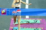 Radcliffe crosses the finish to win the San Juan 10km (Copyright: Brian J. Myers / Photo Run)