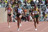 Carmelita Jeter outsprints Shelly Ann Fraser in the 4x100 at the Penn Relays (Kirby Lee)