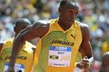 Usain Bolt takes the baton at the Penn Relays (Kirby Lee)
