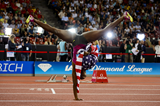 Dawn Harper Nelson celebrates her victory in the 100m hurdles with her trademark cartwheel (AFP / Getty Images)
