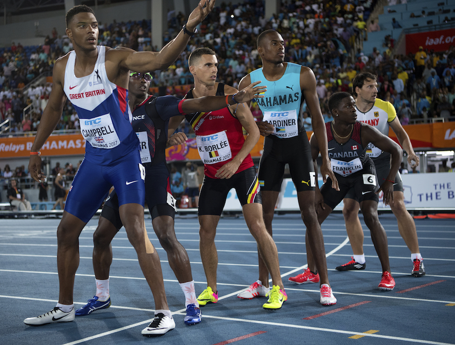 Baton exchange during the men's 4x400m by Jeff Cohen