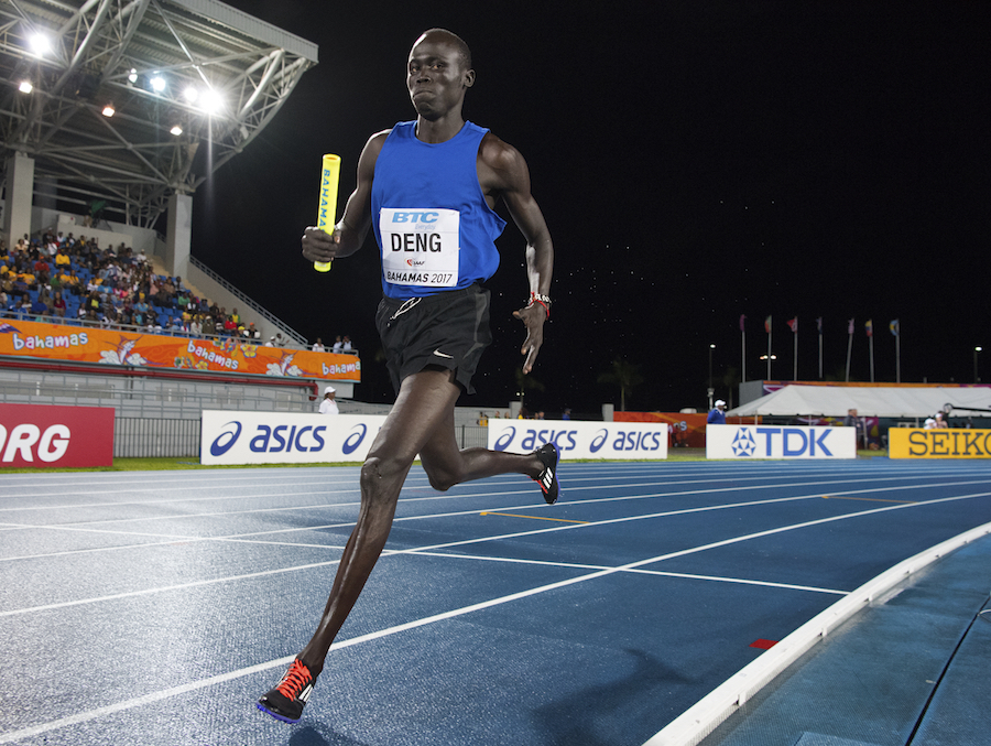 Wiyual Puok Deng of the Athlete Refugee Team during the men's 4x800m by Jeff Cohen