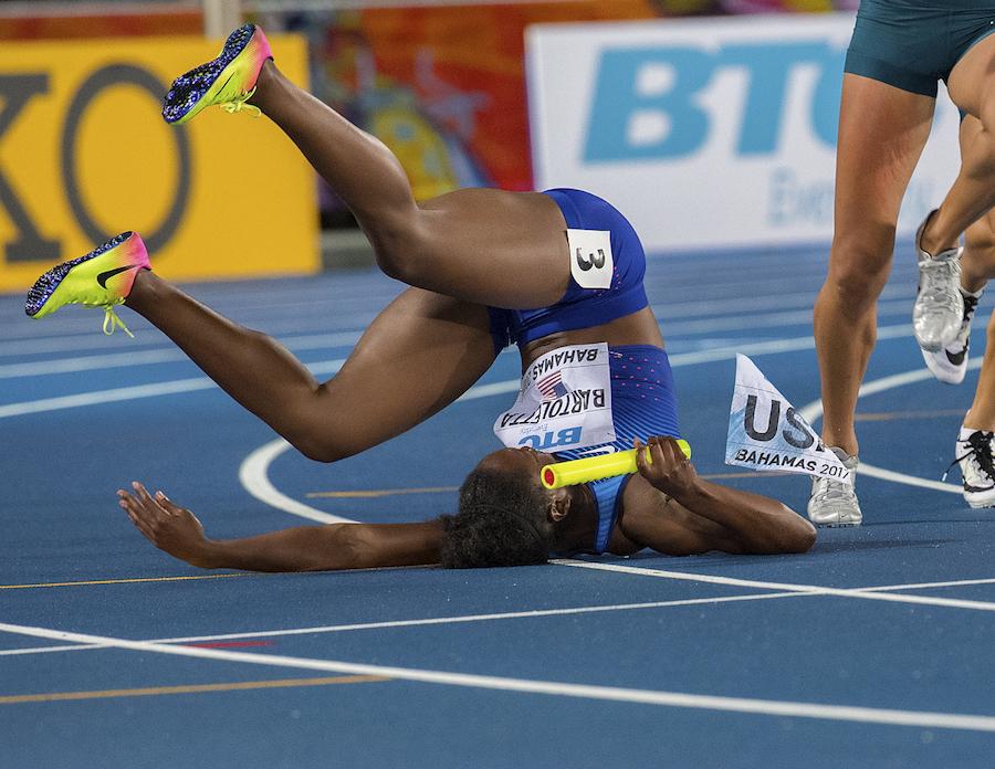 Tianna Bartoletta slips during the women's 4x100m final by Jeff Cohen