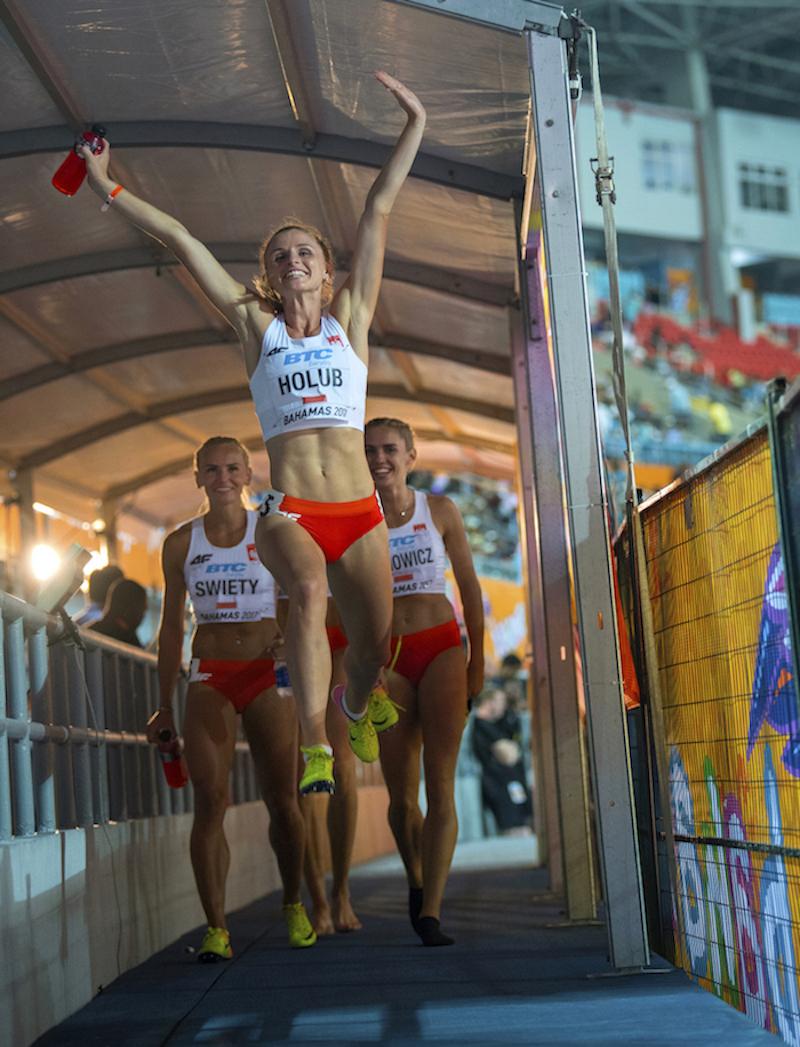 Poland's Malgorzata Holub celebrates after the women's 4x400m by Jeff Cohen