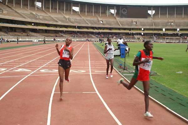 Florence Kiplagat crosses the finish line of the 5000 metres ahead of Mary Wacera and Veronica Wanjiru (Peter Njenga)