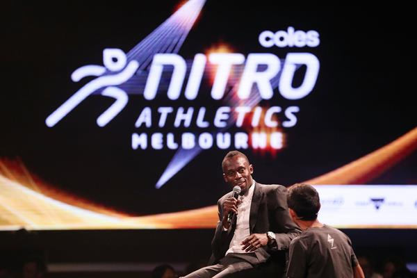 Usain Bolt speaks with a young fan at the Nitro Athletics Gala Dinner in Melbourne (Getty Images)