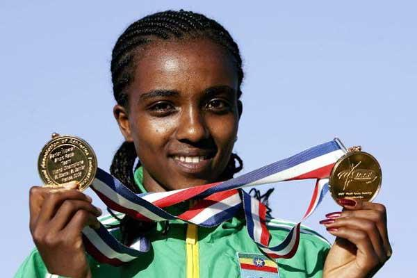 Tirunesh Dibaba with World Cross gold medals (Getty Images)