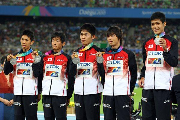 (L-R) Silver medallists Yukihiro Kitaoka, Yoshinori Oda, Yuki Kawauchi, Kentaro Nakamoto and Hiroyuki Horibata of Japan celebrate on the podium with their medals for the marathon team in Daegu 2011  (Getty Images)