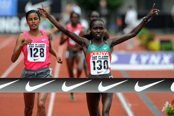 Vivian Cheruyiot (KEN) wins the 2000m at the 2009 Prefontaine Classic; in backround to left is World champion Jamal (Kirby Lee)