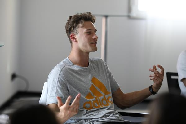 Kurtis Marschall speaking with high school students in Monaco (Philippe Fitte)