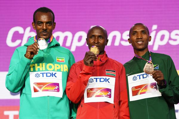 Ethiopia's Tamirat Tola, Kenya's Geoffrey Kirui and Tanzania's Alphonce Felix Simbu pose with their medals after the men's marathon at the IAAF World Championships London 2017 (Getty)