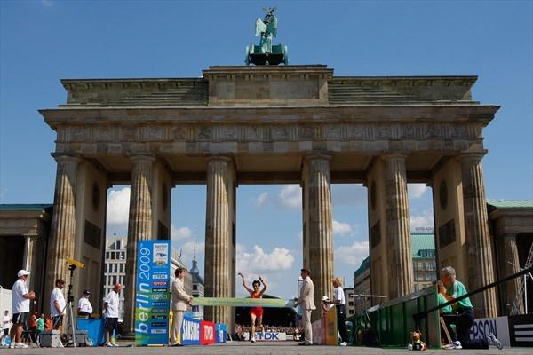 Xue Bai of China crosses the finish line at the Brandenburg gate in the centre of Berlin to win the IAAF World Championship Marathon title (Getty Images)