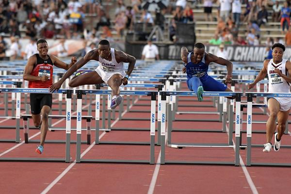 Grant Holloway edges Daniel Roberts 12.98 to 13.00 to take the NCAA title (Kirby Lee)