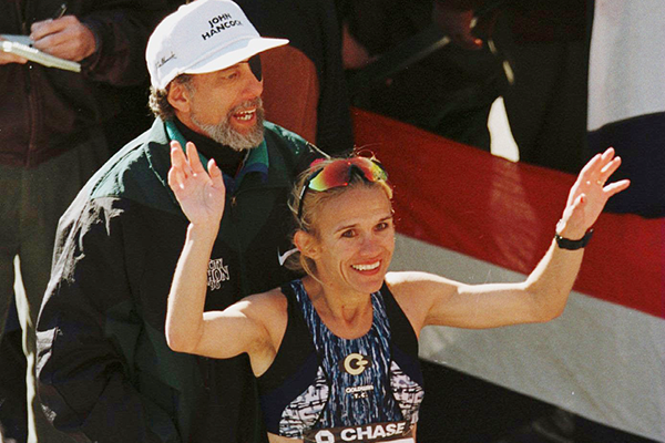 Allan Steinfeld at the 1996 New York City Marathon with winner Anuta Catuna (Getty Images)