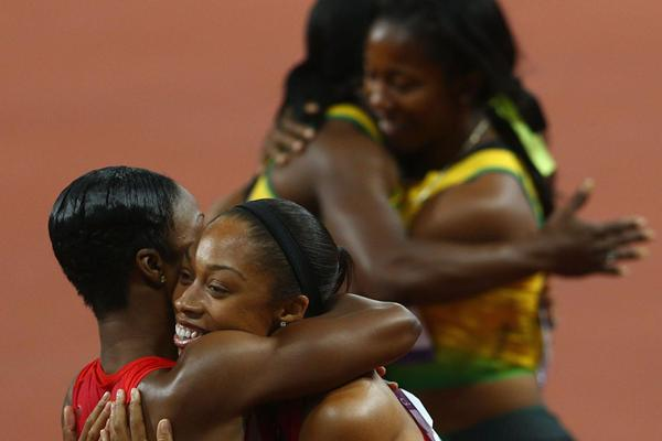 Carmelita Jeter of the United States congratulates Allyson Felix of the United States as Shelly-Ann Fraser-Pryce of Jamaica hugs her teammate Veronica Campbell-Brown of Jamaica after the Women's 200m Final on Day 12 of the London 2012 Olympic Games at Olympic Stadium on August 8, 2012 (Getty Images)