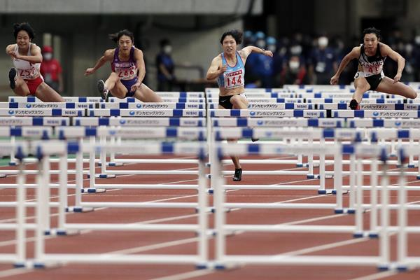 Masumi Aoki (144) on her way to winning the 100m hurdles at the Japanese Championships (Getty Images)