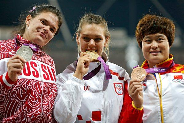 (R-L) Bronze medalist Yanfeng Li of China , gold medalist Sandra Perkovic of Croatia and silver medalist Darya Pishchalnikova of Russia pose on the podium during the medal ceremony for Women's Discus Throw on Day 8 of the London 2012 Olympic Games at Olympic Stadium on August 4, 2012 in London, England (Getty Images)