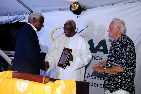 Mike Sands, Vice Chairman of the LOC receives an IAAF Hononary Plaque from President Diack at the IAAF/LOC dinner in Nassau;  (Getty Images)