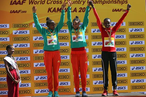 Women's U20 podium, World Cross Country Championships Kampala 2017: winner Letesenbet Gidey (c), silver medallist Hawi Feysa (l) and bronze medallist Celliphine Chespol (Roger Sedres)