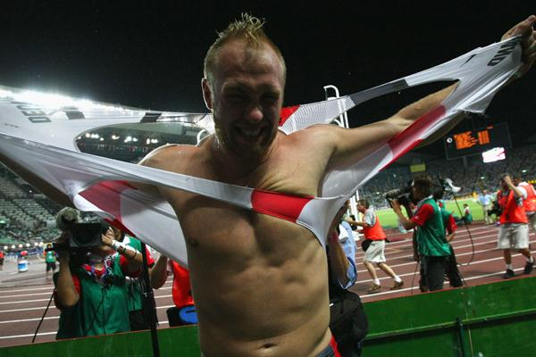 Robert Harting of Germany rips his shirt off in celebration after taking silver in Osaka (Bongarts/Getty Images)