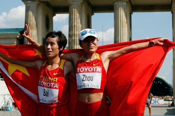 Xue Bai of China celebrates with her team mate Xiaolin Zhu after the women's Marathon in Berlin (Getty Images)