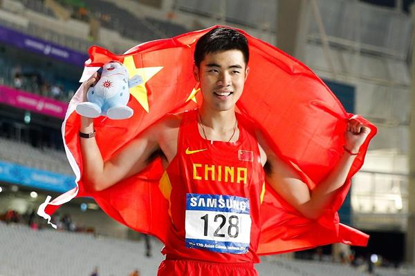 Xie Wenjun after winning the men's 110m hurdles at the 2014 Asian Games (Getty Images)