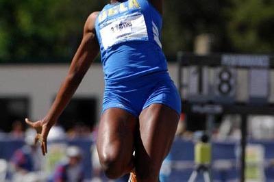 Rhonda Watkins jumps 6.96 to win the NCAA Championships (Kirby Lee)