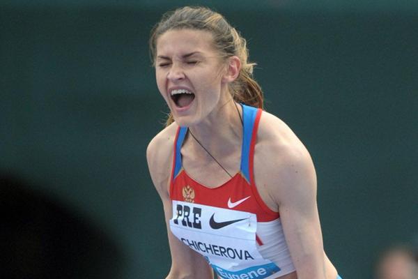 Anna Chicherova celebrates her 2.02m victory in Eugene (Kirby Lee - Image of Sport)