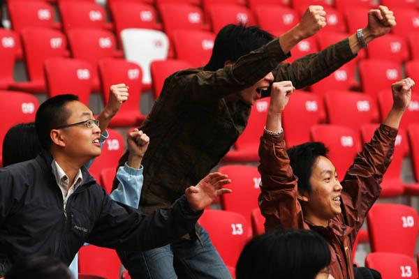 Fans enjoying the 50km Race Walk in Beijing, the first Olympic athletics test event (Getty Images)