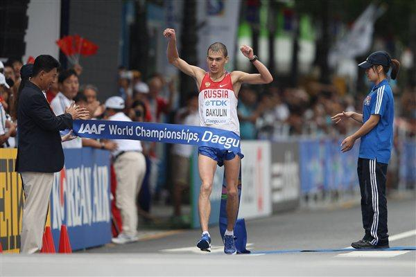 Sergey Bakulin of Russia crosses the finishing line to win gold in the Men's 50 Kilometres Race Walk Final (Getty Images)