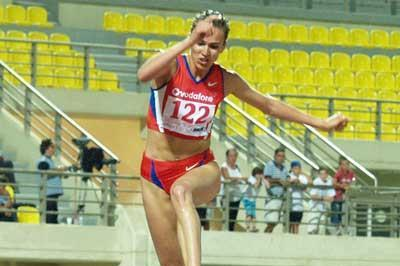 Gulnara Samitova at the water jump on the way to World record (Serafim Tracharis for the IAAF)