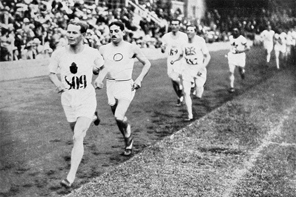 Hannes Kolehmainen leads the 1912 Olympic 5000m final from Jean Bouin and George Hutson (IOC)