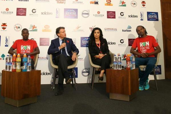 At the 2016 Beirut Marathon pre-race press conference on 12 November, from left: defending champion Jackson Limo, IAAF President Sebastian Coe, race founder May El Khalil, and Sisay Jisa (organisers)