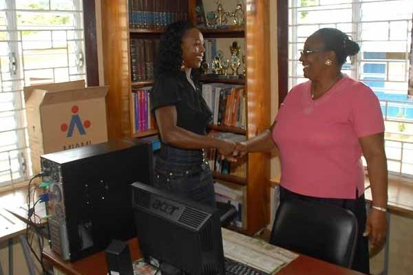Veronica Campbell-Brown with Carmen Daley, the principal of her former school in Troy, Trelawny, Jamaica (Paul Reid)