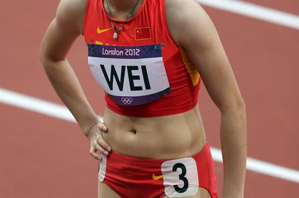 Yongli Wei of China competes in the Women's 100m Round 1 Heats on Day 7 of the London 2012 Olympic Games at Olympic Stadium on August 3, 2012 (Getty Images)