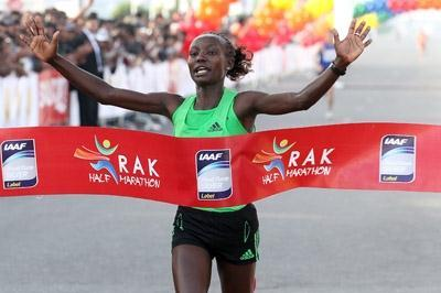 Mary Keitany smashing the Half Marathon World record in Ras Al Khaimah (Victah Sailer)