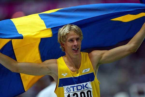 Christian Olsson flies the flag after winning the 2003 World title (Getty Images)
